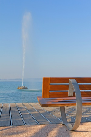 Modern benches along the coastline of Lake Garda  Benches and a fountain in the lake   Bardolino,Italy  Stock Photo