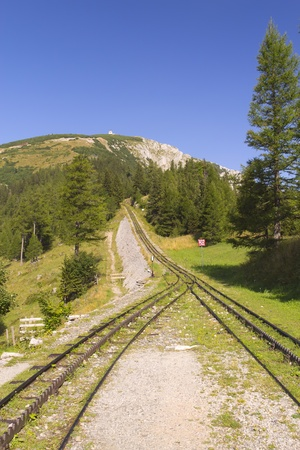 schneeberg: Mountain view with cogwheel railway  Mountain named Schneeberg, Austria   Vertically  Stock Photo