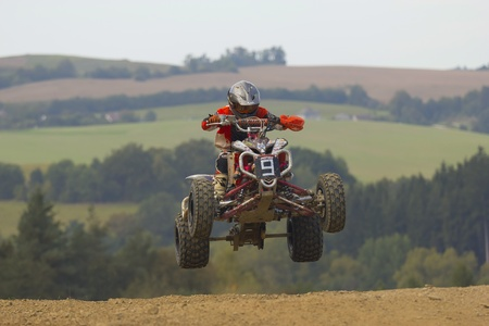 MOHELNICE, CZECH REPUBLIC - SEPTEMBER 17. Unidentified racer jump with a quad motorbike in the Czech Republic Cup 2011 on September 17, 2011 in the town of Mohelnice, Czech Republic.