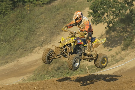 MOHELNICE, CZECH REPUBLIC - SEPTEMBER 17. Unidentified racer jump with a quad motorbike in the