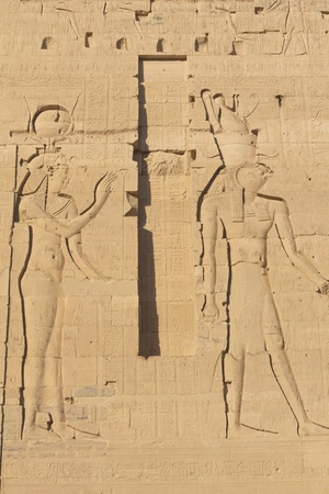 Carving of Egyptian god on pylon in Temple of Isis at Philae, Egypt  photo