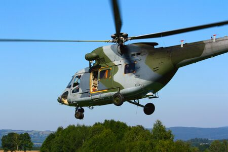 Landing military transport helicopter