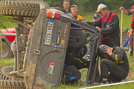 MOHELNICE, CZECH REPUBLIC - JUNE 10. Unidentified racer flipped his car on its side  in the
