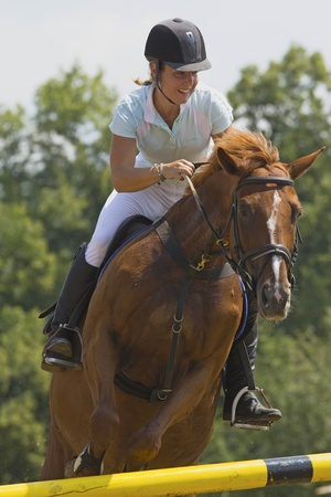 TRESTINA - JULY 07: Unidentified woman rider in action at Jump equestrian Moravian Championship on July 07, 2012 in Trestina (Czech Republic)