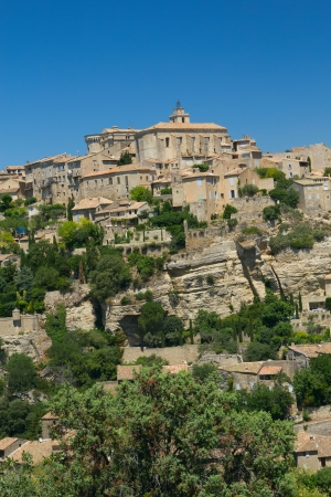 View of the hilltop village of Gordes   Provence, France   This village has a typical Provencal character  Vertically  photo