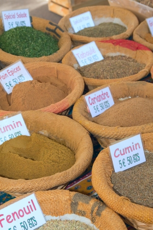 Various kinds of spices prepared to sell on a market