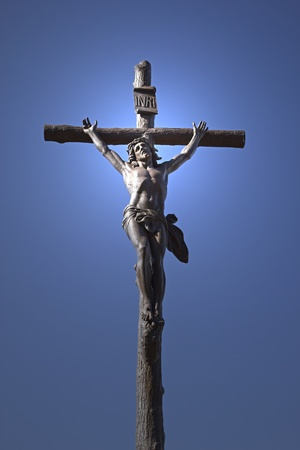 Statue of Jesus Christ on a cross  Blue sky in the background  Vertically  photo