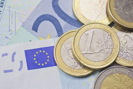 Detailed view of euro coins lying on paper money  Background  photo