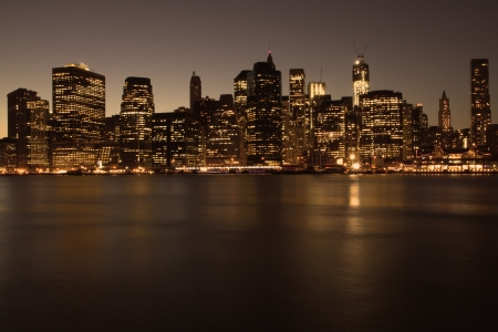 midtown manhattan: Lower Manhattan in New York City at night with reflection in water