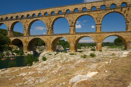 The Pont du Gard is an ancient Roman aqueduct bridge that crosses the Gardon River in Provence  France  photo