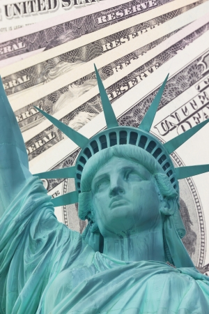 Detailed view of Statue of Liberty and background with money US dollar bills  photo