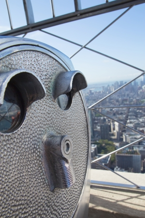 Telescope  binoculat  on the top of the Empire State Building  New York City, USA  photo