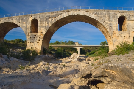 Pont Julien in Bonnieux in Provence  France   The original Roman bridge  The new bridge is in the background  photo