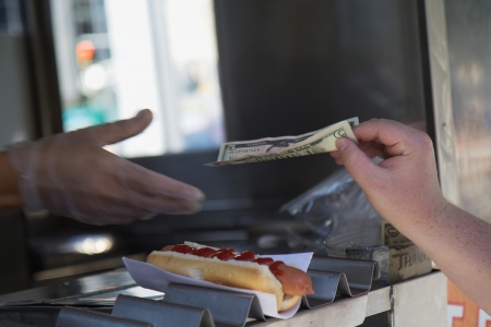 Street stall to sell hot dogs  Paying for purchased hot dog   New York City, USA Stock Photo - 17296021