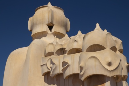 BARCELONA. APR 24: Casa Milà. On the rooftop there are twenty-eight chimneys in several groupings  twisted so that the smoke came out better.  2013 in Barcelona, Spain.