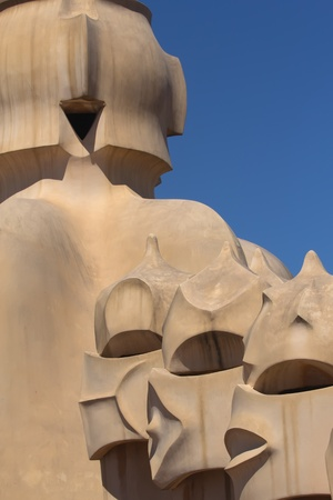 groupings: BARCELONA. APR 24: Casa Mila. On the rooftop there are twenty-eight chimneys in several groupings  twisted so that the smoke came out better.  2013 in Barcelona, Spain.  Editorial