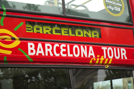 busses: BARCELONA - APR 26: Barcelona Tour has Hop-on hop-off red busses that run between the three tour routes and 45 different stops. April 26, 2013  in Barcelona