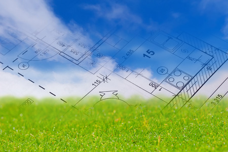 Background with blue sky, green land and blueprint of a house interior. 版權商用圖片