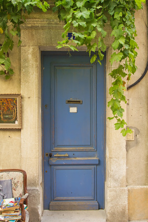 Old blue entrance door to the house with creeper.Mediterranean architecture. photo