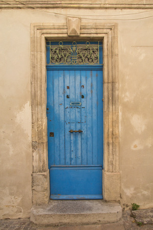 Old blue wooden entrance door to the house. Mediterranean architecture. photo