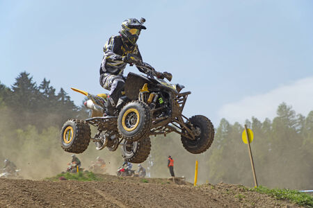 MOHELNICE,  CZECH REPUBLIC - APRIL 19: Racer with camera is jumping a quad motorbike in the International Championship of the Czech Republic 2014 on April 19, 2014  in MOHELNICE, Czech Republic.