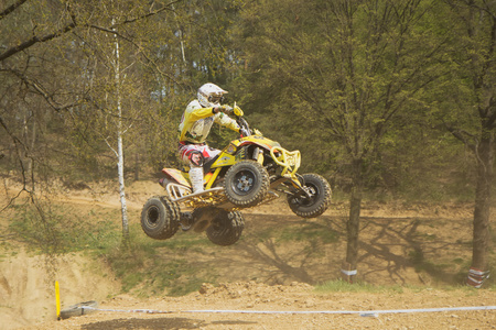 MOHELNICE,  CZECH REPUBLIC - APRIL 19: Racer racer in yellow is jumping a quad motorbike in the International Championship of the Czech Republic 2014 on April 19, 2014  in MOHELNICE, Czech Republic.