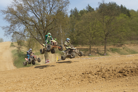MOHELNICE,  CZECH REPUBLIC - APRIL 19: Trinity of quad riders are jumping a quad motorbike in the International Championship of the Czech Republic 2014 on April 19, 2014  in MOHELNICE, Czech Republic.