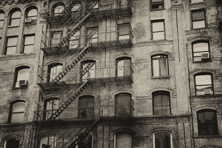 Vintage photo of old building with outdoor staircase (New York City, USA). Horizontally. Stock Photo