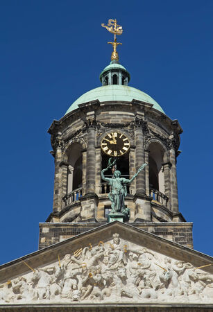 dam square:  Royal Palace at the Dam Square, Amsterdam. Closeup view of the tower. Editorial