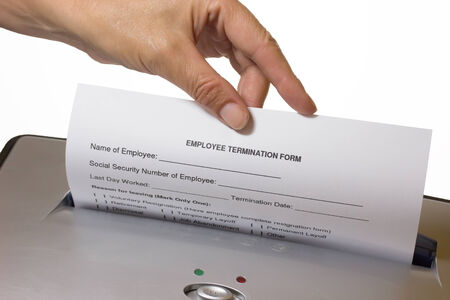 termination: Hand of woman is discarding a employee termination form  On the white background