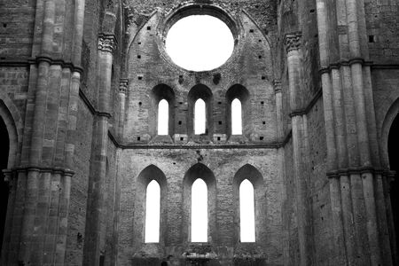 Black and white photo of the San Galgano church ruins. The abbey was abolished in 1652. (Tuscany, Italy)