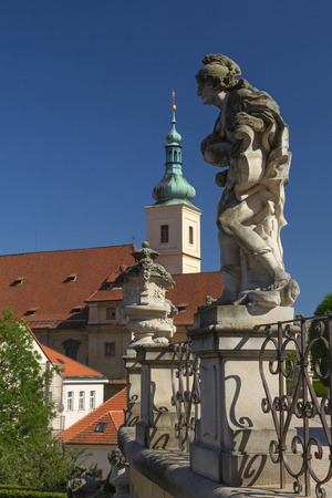notability: Baroque staues and famous Church of Our Lady of Victory in the background. View from Vrtbovska Garden (Prague)