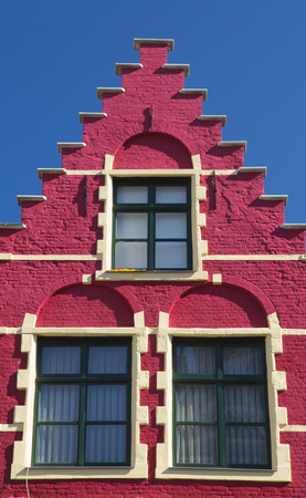gable house: Red gable roof of the historic house (Bruges, Belgium). Front view.