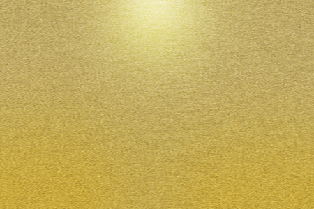 texture background: Pattern of brushed gold metal background. Subdued light is in the upper middle part of the background.