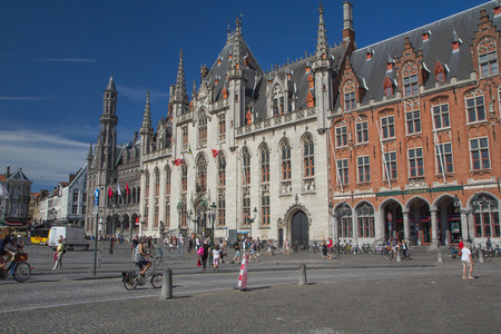 hectare: BRUGES, BELGIUM-JUN 23: The Market Square of Bruges is located in the heart of the city and covers an area of about 1 hectare. In 1995 the market was completely renovated. On June 23, 2014  in BRUGES, Belgium. Editorial