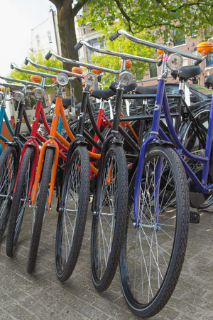 readily: AMSTERDAM, NETHERLANDS- JUN 26: Bicycle rentals are readily available throughout the city. Central Station, Leidseplein and Dam Square are all major rental hubs. On June 26, 2014  in AMSTERDAM, Netherlands. Editorial