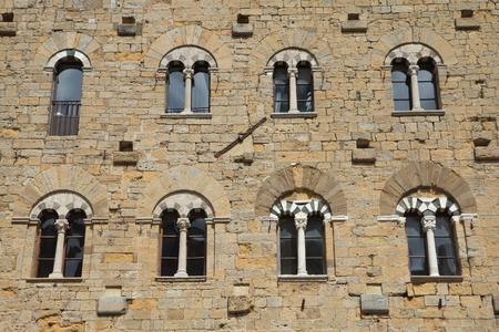 priori: Detail of ancient architecture on the famous Piazza dei Priori (Volterra, Italy) Stock Photo