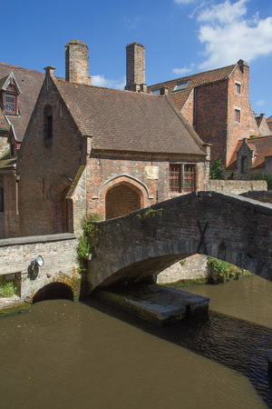 The famous ancient old stone bridge in Bruges (Flanders, Belgium) photo