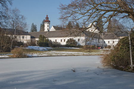 velke: General view of the castle Velke Losiny with a frozen pond in the park (Czech Republic)