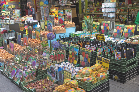 places of interest: AMSTERDAM- JUNE 25: Flower market is the only floating flower market in the world, and one of the most fragrant places of interest of Amsterdam - in all seasons. The flower stalls stand on the houseboats. June 25,  2014  in Amsterdam