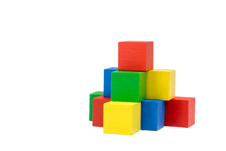 variously: Pyramid built from variously wooden colorful cubes on an isolated white background. The red cube is on the top of the pyramid. Side view.
