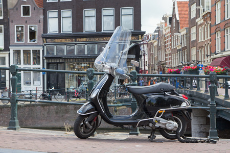 evolved: AMSTERDAM, NETHERLANDS- JUN 26: .The Vespa has evolved from a single model motor scooter manufactured in 1946 by Piaggio & Co. S.p.A. of Pontedera, Italy. On June 26, 2014  in Amsterdam, Netherlands