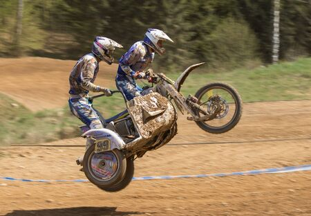 sidecar: MOHELNICE, CZECH REPUBLIC - APRIL 25. Dynamic shot of sidecar jumping in the race of International Championship of Czech Republic in sidecarcross 2015 on April 25. 2015 in Mohelnice.
