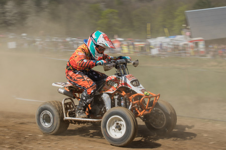 dynamic motion: MOHELNICE, CZECH REPUBLIC - APRIL 25. Junior quad rider in the dynamic motion in the International Championship of Czech Republic in Quad 2015 on April 25. 2015 in Mohelnice.