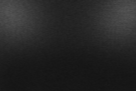 Pattern of brushed black metal background. Subdued light is at the top left and right side image. Standard-Bild