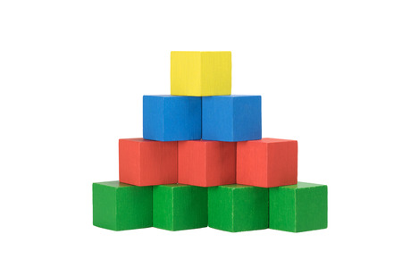 red building blocks: Pyramid built from wooden colorful cubes isolated on a white background. Bottom line consists of green cubes over which there are three red cubes over which there are two blue cubes on top is a yellow cube. Front view