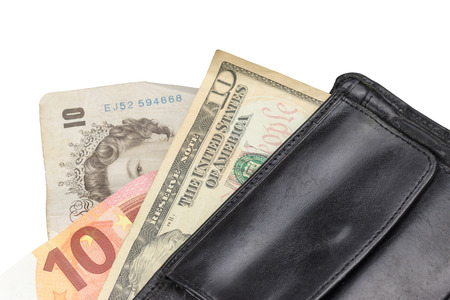 laundered: Ten pounds banknote, ten euro banknote and the ten dollar banknote in black wallet isolated on the white background. Stock Photo