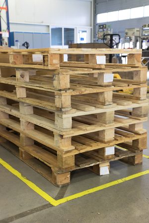 assembly hall: Wooden pallets are made up at a designated place in the assembly hall. All potential trademarks are removed.