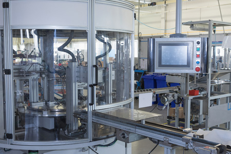 General view of the automatic production line with a control panel. All potential trademarks are removed.