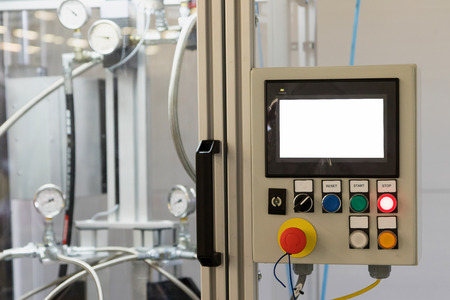 Control panel of production line with buttons Reset, Start and Stop. The screen of this device is white - ready for your text. All potential trademarks are removed.